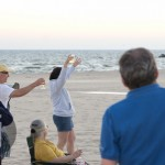 """Toast the Sunset"" Celebrating the Solstice on the Beach in Muskegon"